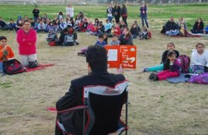 Principal Alex Morales reads to the students. (Contributed)