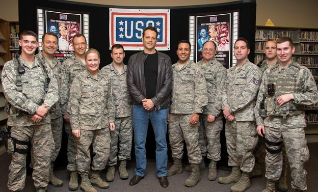 "Actor Vince Vaughn poses for photos with Edwards Airmen and their families at the base library before introducing an advance screening of his new movie, ""Unfinished Business,"" at the base theater Feb. 28. (U.S. Air Force photo by Christian Turner)"
