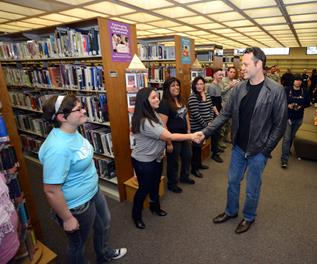 Actor Vince Vaughn meets with Edwards Airmen and their families at the base library before introducing an advance screening of his new movie. (U.S. Air Force photo by Jet Fabara)