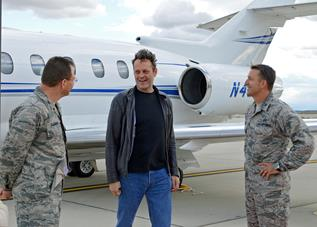 Col. David Radomski (left), 412th Test Wing vice commander, and Col. Eric Leshinsky, 412th Mission Support Group commander (right) welcome actor Vince Vaughn upon his arrival. (U.S. Air Force photo by Jet Fabara)