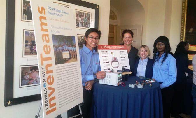 Jonathan Hernandez (far left) and Fanta Sinayoko (far right) attending the 2015 White House Science Fair with their teacher, Rachel Thibault, and Lemelson-MIT Program's invention education officer, Leigh Estabrooks. (Contributed)