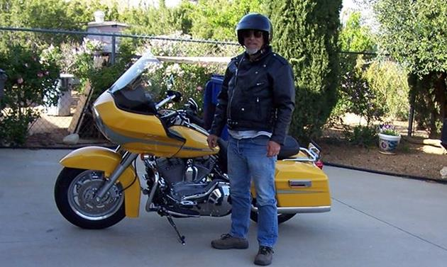 """Glenn Grimm was one of the few motorcycle enthusiasts in the Antelope Valley who rode a yellow Harley-Davidson. Glenn bought the bike after a 2005 accident """"so that everyone would see it and no one would hit him again,"""" his son said. [Photo courtesy Sally Grimm]"""
