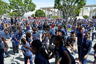 "Under the Guinness World Records rules, the ""Largest Ribbon Dance"" record is for the greatest number of people at a single venue who simultaneously perform the same choreographed dance for a minimum of five minutes using handheld sticks with attached ribbons. (Photo courtesy Ronda Harrison)"