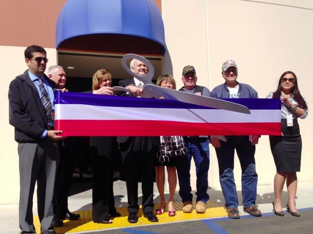 Members of the VA Greater Los Angeles Healthcare System perform a ribbon-cutting ceremony to celebrate Friday's grand opening of the new VA Lancaster Community Based Outpatient Clinic. (photo by Jim E. Winburn)