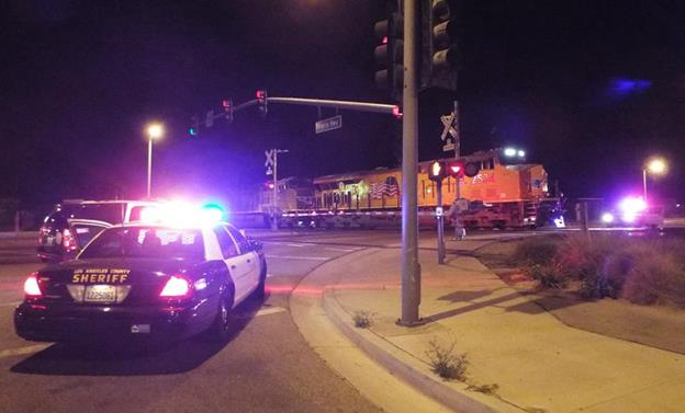 Lancaster Sheriff's Station received a call of a man down behind the Metrolink Station in the 44800 block of Sierra Highway. When deputies responded, they found an adult black male had been hit by a Union Pacific Train. (Photo by LUIS MEZA)