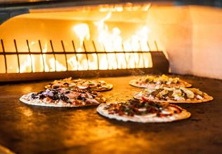 """Guests who visit PizzaRev from 10:30 a.m. to 10 p.m. Thursday, April 2, are invited to """"pay-what-they-want"""" for a custom-built, personal-sized pizza; and 100 percent of the proceeds will go to Gabriel's House."""