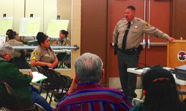 LASD Captain Patrick Nelson of the Lancaster Sheriff's Station and members from the Community Oriented Policing Services (COPS) Bureau inform local residents on the results of the Quartz Hill Community Survey from March 14. (photo by Jim E. Winburn)