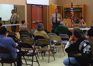 Local residents from Quartz Hill discuss the results of a March 14 Community Oritented Policing Survey with LASD Captain Patrick Nelson of the Lancaster Sheriff's Station. (photo by Jim E. Winburn)