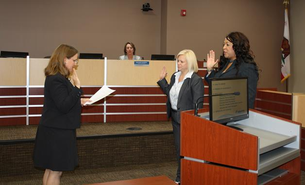 Michelle Flanagan [left] and Angela Underwood-Jacobs [right] is sworn-in as Director Dianne Knippel looks on. (Contributed photo)