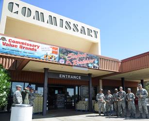 Airmen from the 31st Test and Evaluation Squadron wait outside the Commissary each with a single red rose for Araceli Martinez. (Rebecca Amber)