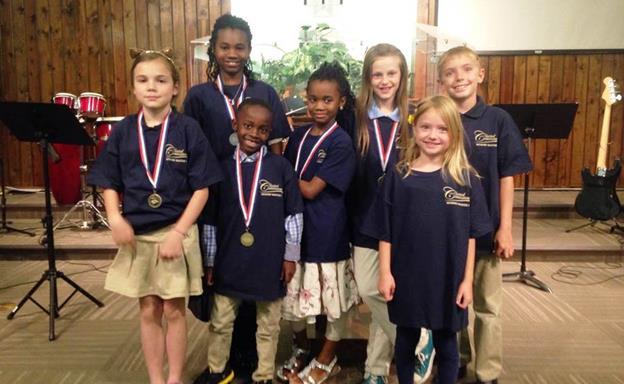 Local Memory Masters [L to R] Kate Priest, 9, Saysha Brown, 11, Judah Brown, 7, Kyra Brown, 9, Sophie Schroeder, 10, Eva Sepp, 6, Caden Sepp, 8. (Contributed)