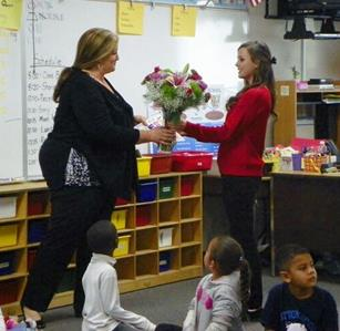 Tiffany presents her favorite teacher with a bouquet of flowers. (contributed)