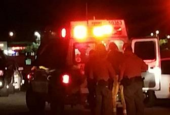 Local paramedics tend to the victim June 3 in the 1800 block of Linda Avenue in Lancaster. (Photo by LUIS MEZA)
