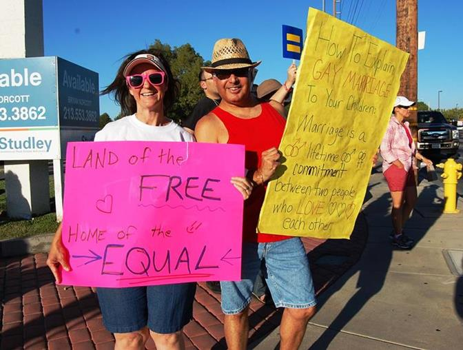 Gina Piellusch and Eric Morga at a marriage equality rally held in Lancaster in 2013. (file photo)
