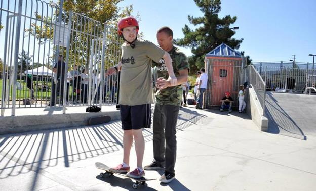 Local teacher and lifelong skateboarder Jeff Ryckebosh lends a hand to Torin Houle at the A.skate clinic at Marie Kerr Park in 2013. View many more pictures from the clinic's local debut in 2013 here.