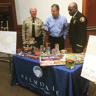 Captain Don Ford, Mayor Jim Ledford and Assistant Fire Chief Gerald Cosey look over a display of confiscated illegal fireworks at a fireworks safety press conference held in Palmdale Monday, June 15. (contributed)