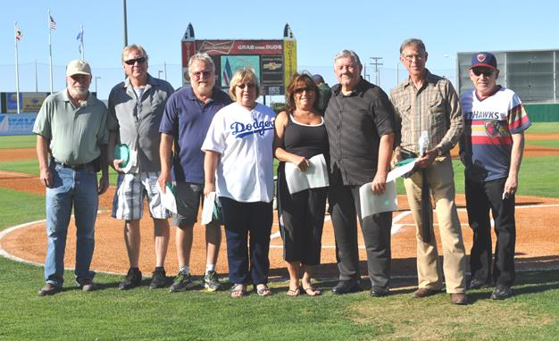"""The Diamond Donor award ceremony took place July 11 on """"AVH Night at JetHawks stadium."""" Pictured from left to right are:  AVH Director of the clinical laboratory, Larry Walker; Manager of AVH's biomedical department, Charles """"Dave"""" White (84 pints); Gene M. Borrelli (91 pints); Jane L. Gordon (88 pints); Joan M. Paolo (94 pints); Byron W. Glennan (84 pints);Barry J. Levine (81 pints); with Jack Burke, AVH COO/interim CEO. Donors not pictured include: Paul S. Hirose (94 pints) and Jon M. Bell (82 pints). [contributed]"""