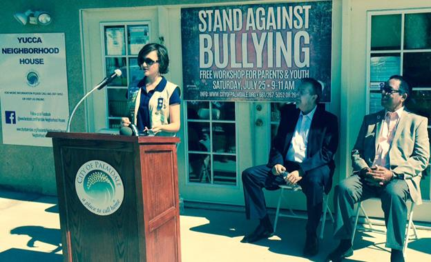 Girl Scout Jo Barrera announces the new anti-bullying workshops coming to the City of Palmdale's Neighborhood Houses, while Mayor Jim Ledford and Councilmember Fred Thompson look on. (contributed)