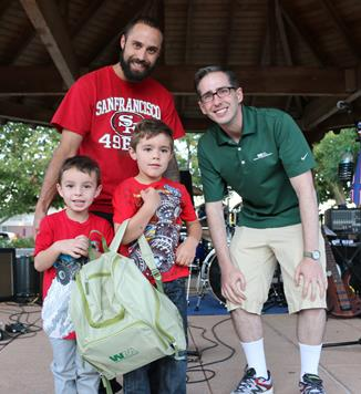 "Last week's ""Green Handed"" winner Gavin Cesena (center), is surrounded by his little brother Deagan, father and Waste Management's Josh Mann."