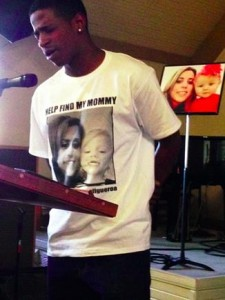 """Kavon White prays for Monique """"Mo"""" Figueroa's safe return to her family and friends. (photo by Jim E. Winburn)"""