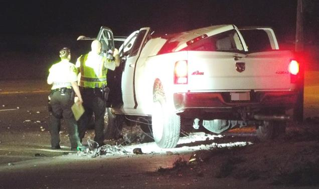 The driver of the truck, the vehicle's sole occupant, was transported to the hospital where he died of his injuries about 35 minutes later, sheriff's officials said. (Photo by LUIS MEZA)