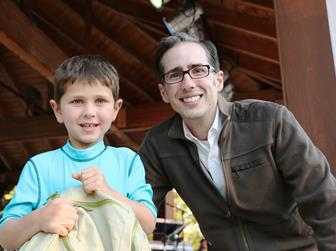 """Luke Newton of San Clemente, posing with Waste Management's Josh Mann, was the winner of a recycled backpack filled with goodies in last week's """"Green Handed"""" contest. (contributed)"""