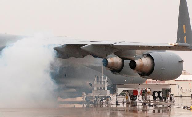 Volcanic ash is sprayed into one of the F117 engines of a C-17 during the final phase of the Vehicle Integrated Propulsion Research project July 9 at Edwards. (NASA AFRC photo by Tom Tschida)
