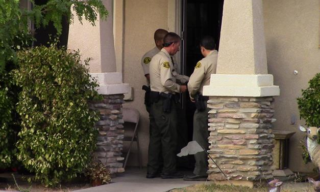 Local deputies shown at a home in the 38000 block of 37th Street East in Palmdale, where a 1-year-old girl was found unconscious in a backyard pool. Jaazae'an Pope was pronounced dead about an hour after the incident was reported. (Photo by LUIS MEZA)