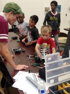 5012 Team member Nickolas Nottebrock helps William Garrett with his robot. (contributed photo)