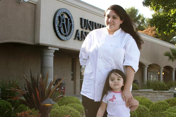 "Tatianna Rodriguez and her daughter at University of Antelope's campus. Three-year-old La'Reina describes her mom's food as ""yummy."" (contributed photo)"