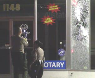 Bullets apparently shattered the glass at the business across the street from the liquor store. [LUIS MEZA]