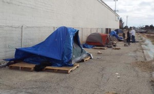 Team members go out into the deserts, inside culverts and behind local businesses – like this shopping center on 20th Street West in Lancaster – to identify and assess the homeless.