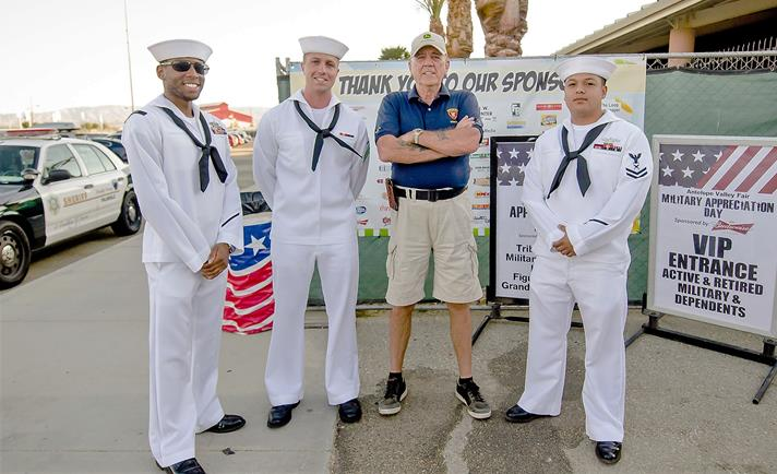 Actor and Marine veteran R. Lee Ermey is pictured with a group of sailors at last year's Military Appreciation Day. [contributed]