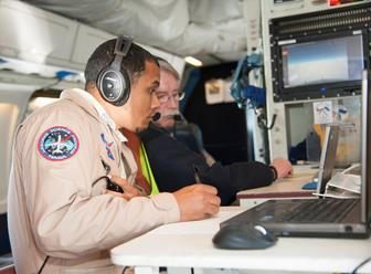 Matt Berry, left, and Chris Jensen, work aboard the DC-8 during a mission in Iceland. [NASA Photo / Carla Thomas]