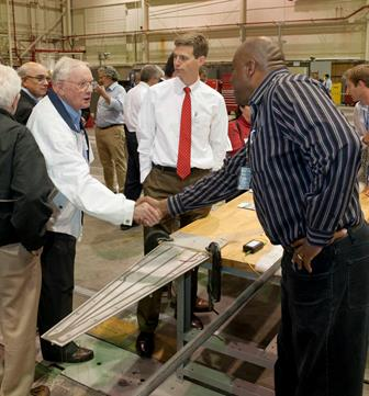 Neil Armstrong was on a National Research Council tour of Armstrong Flight Research Center in 2011, when the center was called Dryden Flight Research Center. Armstrong employee Allen Parker shook hands with him after explaining his research project. [NASA Photo]