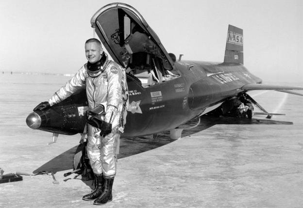 Research Pilot Neil Armstrong posed with the world's first rocket-powered X-15 aircraft that he piloted from 1960 to 1962. The aircraft contributed to the development of all future NASA spacecraft for humans from the Mercury capsule to the Space Shuttle. [NASA photo]