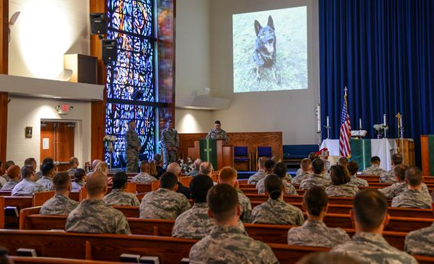 """A memorial service for Rex was held July 31. During the service, the military working dog was honored with the reading of two poems, """"I Wait by the Gate"""" and """"Guardians of the Night."""" (U.S. Air Force photo by Rebecca Amber)"""