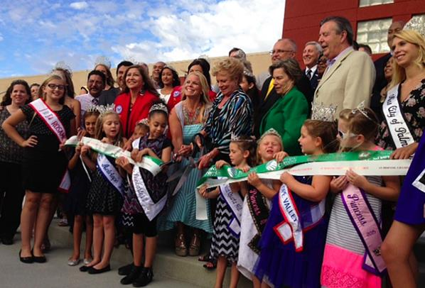 Local dignitaries, Palmdale School District staff, and Antelope Valley Queens take part in a ribbon cutting ceremony to celebrate the grand opening of David G. Millen Intermediate School on Thursday. (Photo by Jim Winburn)