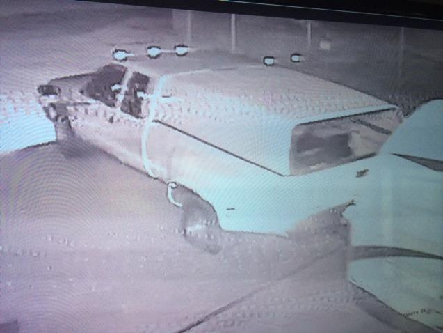 Security cameras depict a white, extra-cab, dually truck with a white camper enter the storage facility through the front gate and leaving the premises with the victims' trailers, sheriff's officials said. [Image courtesy LASD]