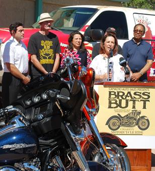 Brass Butt Committee Chair Terri-Lei Wheeler speaks at the press conference. Standing behind her (l to r) are Gus Camacho, Joe Ennis, Patricia Morales, Councilmember Steve Hofbauer and Councilmember Fred Thompson. [contributed]