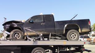 A 2000 Dodge Dakota truck was traveling northbound on Sierra Highway in the No. 2 at approximately 55 miles per hour, officials said. [LUIS MEZA]