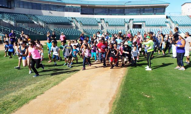 """Laps4Literacy is a community event in the Antelope Valley that promotes the importance of literacy in conjunction with Child Care Resource Center's literacy campaign, """"What a Difference a Book Makes."""" [contributed]"""