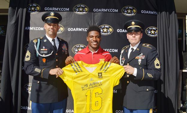 Paraclete High School running back Melquise Stovall, flanked by (left to right) Major Sargeant Paul De Lemos and Staff First Class Armando Delgado, holds up his jersey after being named to the 2016 U.S. Army All-American Bowl at a Sept. 29 ceremony on campus in Lancaster. (contributed)