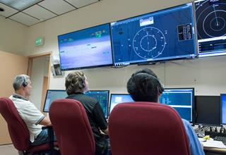 NASA researchers (from left) Martin Hoffman, John Freudinger, and Ed Koshimoto observe one of the FT3 tests from the Research Ground Control Station at NASA Armstrong. [NASA Photo / Ken Ulbrich]
