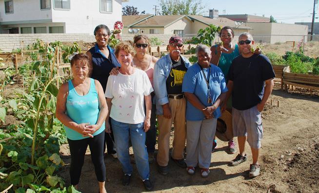 The gardeners: Front L/R: Elizabeth Santa, Lorraine Seiler, Al Burrola, Samira Mujahid-Burrola, Ian Grant. Back L/R: Garlenia Davis, Linda Seiler, Mary Settle. [Contributed]