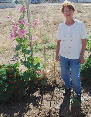 Lorraine Seiler with her flowering vine.