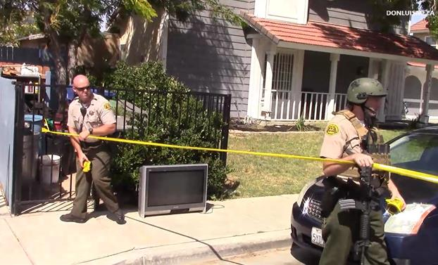 Deputies use police tape to cordon off the home where the deadly altercation took place Sept. 4. (Photo by LUIS MEZA)