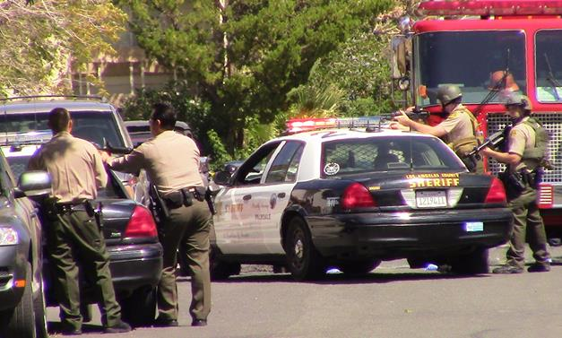 Following the shooting, about two dozen sheriff's deputies surrounded a Palmdale home . in the 200 block of East Avenue R-3 and gave orders for a female suspect to surrender. [Photo by LUIS MEZA)