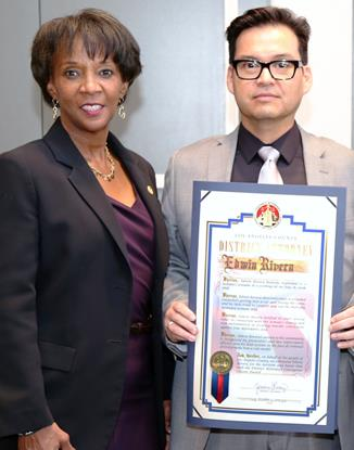 District Attorney Jackie Lacey honors Palmdale resident Edwin Rivera for his heroic actions at the Courageous Citizen Awards in Downtown Los Angeles. [Photo credit: Los Angeles County District Attorney's Office]