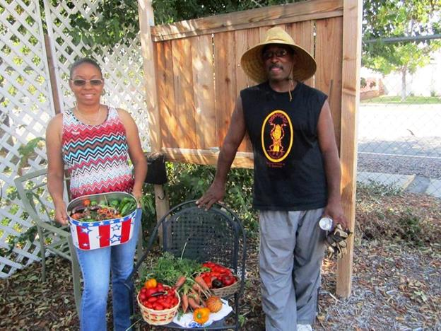 Garden volunteers Veronica Fields and Richard Triplett at a previous event at the Elm Avenue Community Garden in Lancaster. [contributed]
